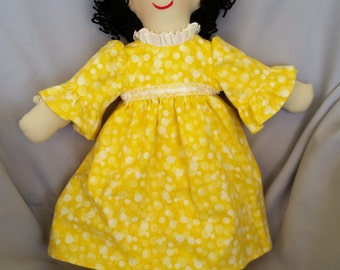 Old fashioned 15 inch cloth doll with brown eyes, black hair and yellow nightgown from the Ann Marie Collection