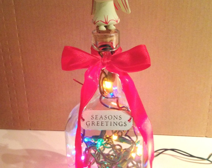 Lighted Holiday Lamp with Festive Angel Topper, Red Bow Trim and Seasons Greetings Exclusive Design Home Decor from Crafts by the Sea.