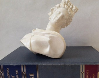 classic bust, reminiscent of Greek or Roman architecture, archaeology