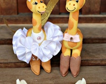 Giraffe wedding cake topper with cowboy and cowgirl boots, country rustic wedding
