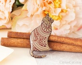 Cat brooch with Indian floral pattern