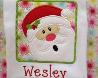 Santa Claus is coming to town.  Appliquéd shirt of Santa. Santa is made from felt.