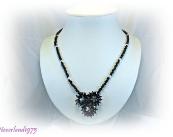 Set consisting of necklace and earrings in weaving seed beads black, bicone jet AB and cabochons crystal