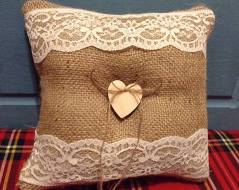 Lovely handmade hessian and lace ring cushion.