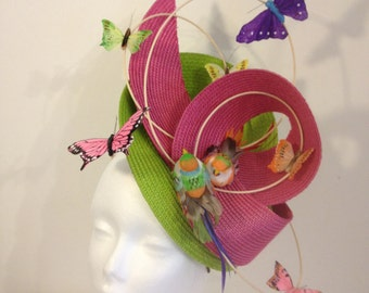 Green Hat foam and fushia with flight of butterflies and multicolored birds