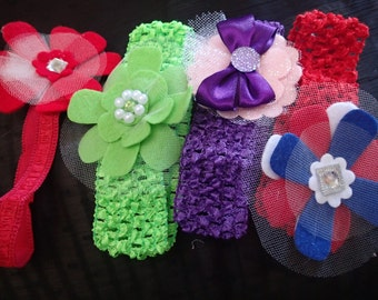 4 different holiday felt flower baby headbands.