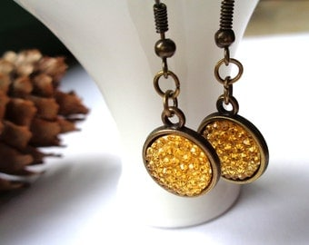 Bronze dangle earrings resin cabochons sparkling honey yellow