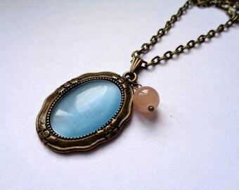 Bronze, bronze tone pendant cateye glass cabochon necklace light blue with beige glass bead