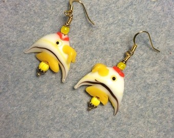 Yellow and white striped lampwork angelfish bead earrings adorned with yellow Czech glass beads.