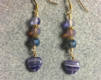 Bluish violet Czech glass heart bead dangle earrings adorned with bluish violet Czech glass beads.