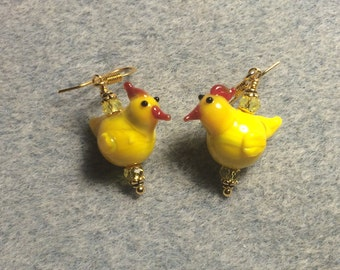 Small yellow lampwork chicken bead earrings adorned with yellow Chinese crystal beads.