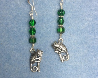 Silver chameleon charm earrings adorned with green Czech glass beads.