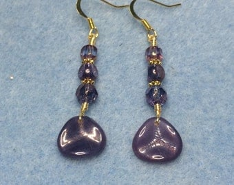 Purple rose petal dangle earrings adorned with purple Czech glass beads.
