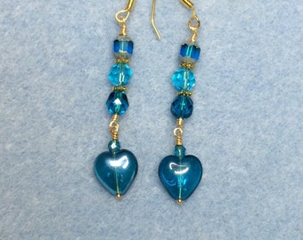 Turquoise Czech glass heart dangle earrings adorned with turquoise Czech glass beads.