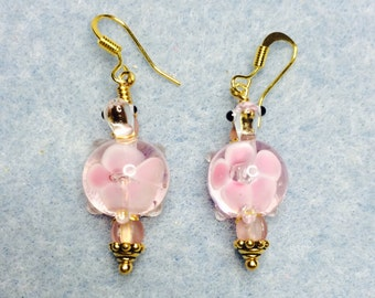 Pink lampwork turtle bead dangle earrings adorned with pink Czech glass beads.