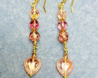 Pink Czech glass heart dangle earrings adorned with pink Czech glass beads.