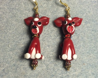 Red puppy dog lampwork bead dangle earrings adorned with red Czech glass beads.