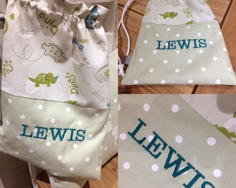 "Clarke & Clarke Dinosaur Sage Dotty Personalised Lined Drawstring Bag 13"" x 18"""