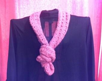 Beautiful pink crocheted scarf.