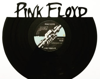 Pink Floyd silhouette vinyl record art. On a replica Pink Floyd Album