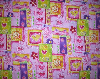 Pink multi color fabric 1 yard 30 inches of cute hearts flowers and much more and is cotton fabric