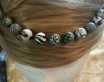 Black and white beaded hair jewelry/headband.  Wear as a band or ponytail holder.