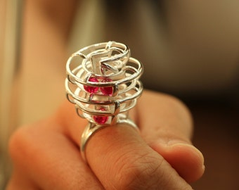 Kinetic Ring - rolling rubies with every movement of the wearer, 3D Printed in sterling silver with ruby, July Birthstone