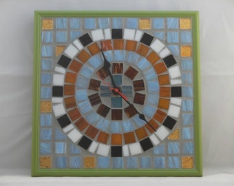 Mosaic tile clock with light green frame.