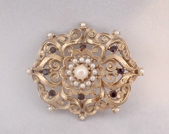 Gold Tone Filigree Brooch with Faux Pearls and Red Rhinestones