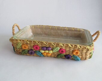 Clear Pyrex dish and wicker holder