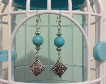 silver plate turquoise dyed  blue jump earring