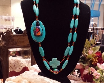 Two strand turquoise beaded necklace with turtle
