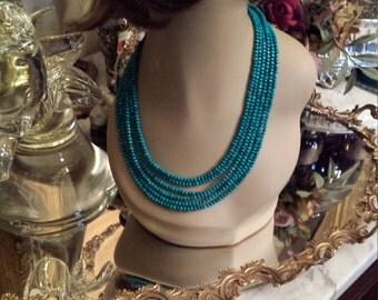 Six strand turquoise beaded necklace