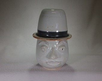 White Stoneware Patient Face Pot with Conical Hat Lid.