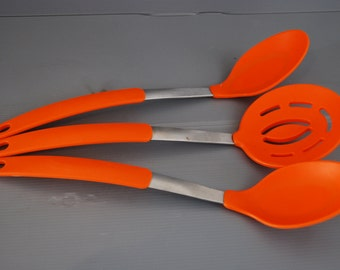 French retro 1980s kitchen ladles and strainer in bright orange plastic and stainless steel. Retro living for your kitchen