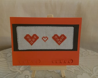 Cross stitched red heart card