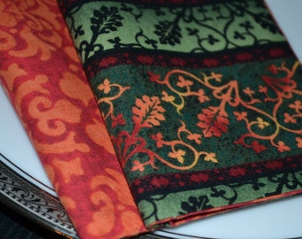 Set of 8 reversible cloth napkins with fall colors.