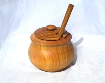 Wooden pot and wooden honey dipper.