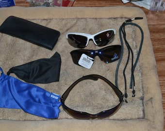 5 Pair New Polarized sunglasses-some with neck stings and covers