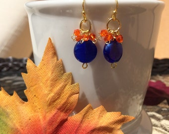 University of Florida Gators Orange and Blue dangle earrings, with gold accents. Perfect for game day!