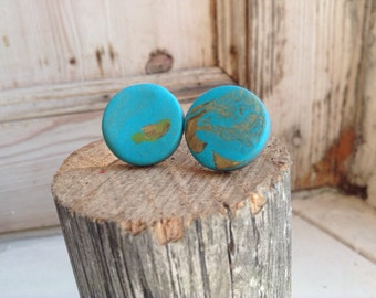 Gorgeous turquoise and gold polymer clay stud earrings.