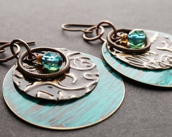"""Made in Montana. """"Verdigris Adorning"""" Embossed natural brass with verdigris patina and Designer Czech glass, teal jewel. HYPOALLERGENIC."""