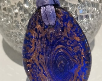 Blue oval pendant with shimmering minerals