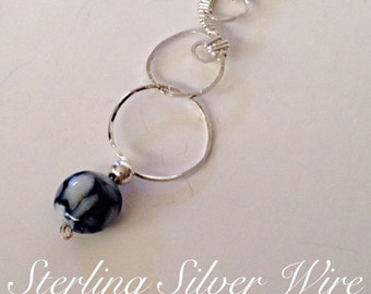 Sterling Silver Mother of Pearl Resin Wire Wrapped Circle Pendant by Nickole Schmidt