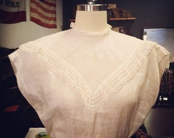 Delicate ivory lace Victorian blouse.