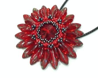 Red and hematite flower Corolla medallion