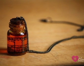 Mini glass jar necklace with film ribbon