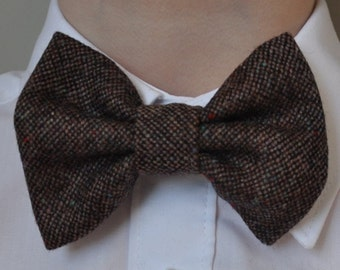 Boys bowtie in brown tweed with a deep red neck strap by Fred's Finery's 'Charlie Rawlins'