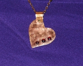 Copper heart with garnet cabochons