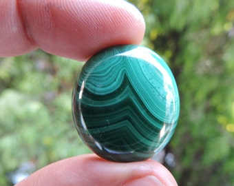 Malachite cabochon with exotic swirls and pattern